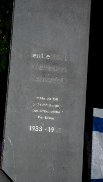 Teilweise entfernte Inschrift